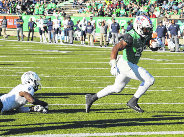 Marshall running back Brenden Knox, right, breaks away from a defender for a score during the second half of an Oct. 12 Conference USA football game against Old Dominion at Joan C. Edwards Stadium in Huntington, W.Va.