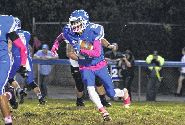 GAHS sophomore Donevyn Woodson (24) carries the ball off tackle, during the Blue Devils' 44-20 victory over Coal Grove on Friday in Gallipolis, Ohio.