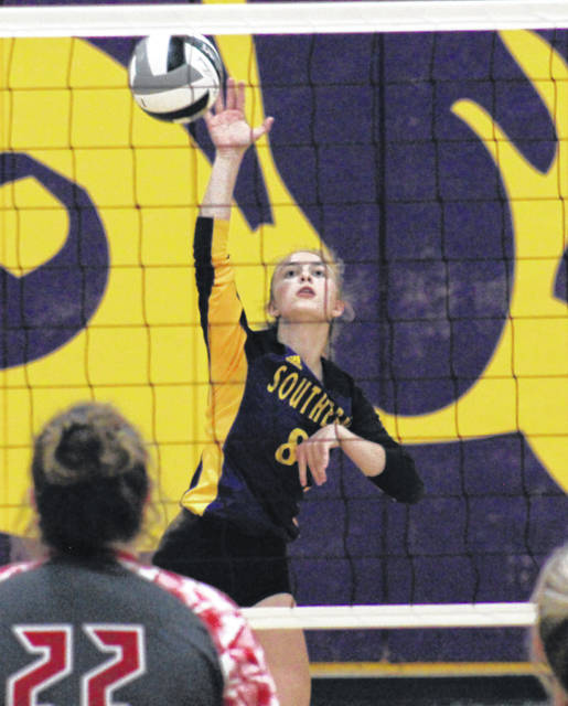 SHS senior Mickenzie Ferrell (8) spikes the ball over the net, during the Lady Tornadoes' sectional championship victory on Thursday in Racine, Ohio.