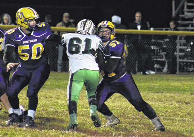 Southern senior Matthias Stansberry (57), alongside classmate Coltin Parker (50), blocks a Wildcat lineman, during Waterford's 42-12 victory on Friday in Racine, Ohio.