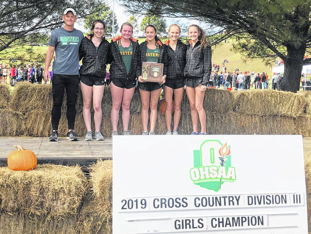 Members of the Eastern girls varsity cross country team pose for a picture after winning the 2019 Division III district championship on Saturday at the University of Rio Grande.