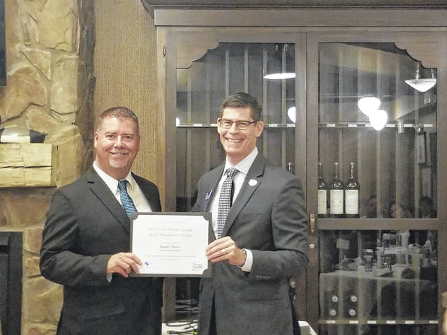 Randy Pierce (left) recently graduated from the 2019 OBL Bank Management School.