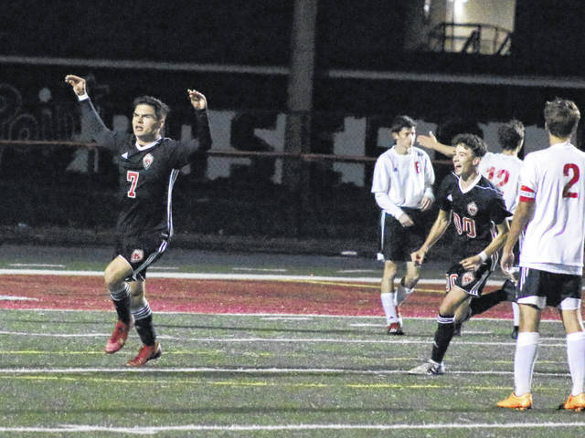 Point Pleasant junior Adam Veroski (7) celebrates after scoring the eventual game-winning goal during the second half of Tuesday night's Class AA-A Region IV, Section 1 semifinal match against Ravenswood in Point Pleasant, W.Va.