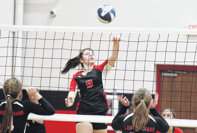 PPHS sophomore Baylie Rickard (9) spikes the ball for a kill, during the Lady Knights' win over Sissonville on Tuesday in Point Pleasant, W.Va.