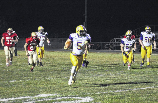 Southern senior Trey McNickle breaks a 20-yard touchdown run, during the first quarter of Southern's 39-14 victory on Friday in Mercerville, Ohio.