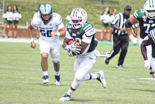 Ohio's O'Shaan Allison carries the ball for a gain, during the Bobcats' season-opening victory over Rhode Island on Aug. 31 in Athens, Ohio.