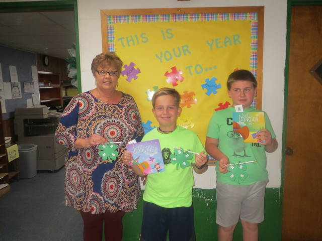 Mrs. Lisa Green, principal of Leon Elementary School, is pictured with Vice President Wyatt Oldaker and President Luke Thomas of the Leon Luckies Club displaying their 4-H pencils.