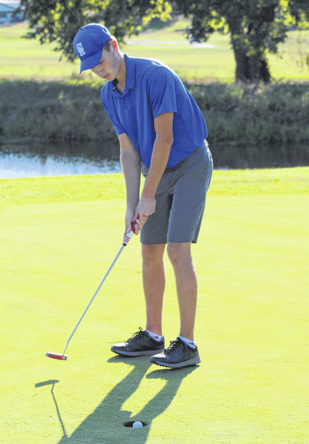 Gallia Academy junior Cooper Davis knocks in a putt during a Sept. 5 match at Cliffside Golf Course in Gallipolis, Ohio.