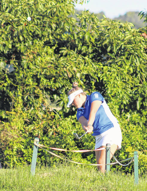 Gallia Academy senior Bailey Meadows hits a chip shot during a Sept. 5 match at Cliffside Golf Course in Gallipolis, Ohio.