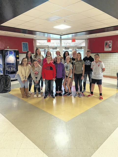 "Pictured are members of the PPJHS National Junior Honor Society who recently partnered with upperclassmen at PPHS for the ""Block the Door"" campaign to collect food items for those in need. Pictured in the front row, from left, Emily Bale, Kami Cundiff, Nathan Wood, Ashley Legg, Malea Bechtle, Lindsay Ward, Pacey Frum; back row, from left McKenna Young, Kendal Connoly, Kyleigh Towe, Kiersten Clendenen, Justice Curry, Robbie Hall, Brecken Loudin."