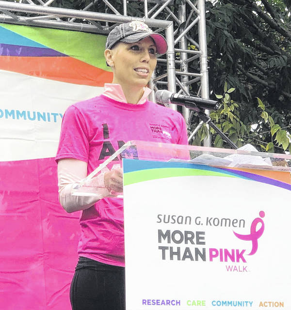 Jodie Penrod speaking at the recent Susan G. Komen More Than Pink Walk ™ held in Athens earlier this month. With the support of family and friends, Penrod was the top fundraiser.