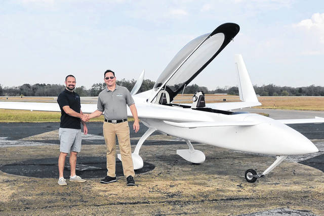 Nate Mullins (left), meets with Jim Smith, director of RCBI AERO, in front of another lightweight aircraft Mullins helped develop. He is one of the owners of Novus Aero Development and has nearly 10 years of experience in designing and manufacturing composite aircraft.