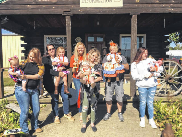 Pictured are the first place winners from Saturday's Pretty Baby Contest held during the Country Fall Festival on the grounds of the West Virginia State Farm Museum, from left, Lacey Rae, seven month old winner, daughter of Marli Johnson and Jacob Lyons of Point Pleasant; Madalyn Payne, 31 month old winner, daughter of Kayleigh and Carry Payne of Apple Grove; Ava Davis, four month old winner and Queen's Choice Winner, daughter of Tyler and Traci Davis of Gallipolis, Ohio; Violet LeMaster, 25 month old winner, daughter of Rebecca and Joe LeMaster of Huntington; and Laken Staats, six week old winner, daughter of Abby Clendenin and C.J. Staats of Point Pleasant.