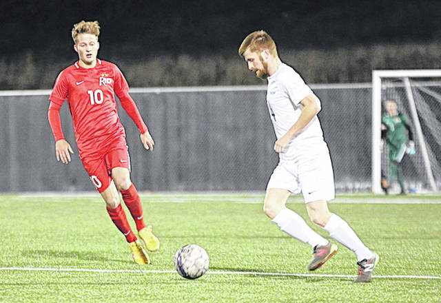Rio Grande's Ewan McLauchlan and WVU-Tech's Gavin Shiels chase after a loose ball during Thursday night's game at the YMCA/Paul Cline Soccer Complex in Beckley, W.Va.