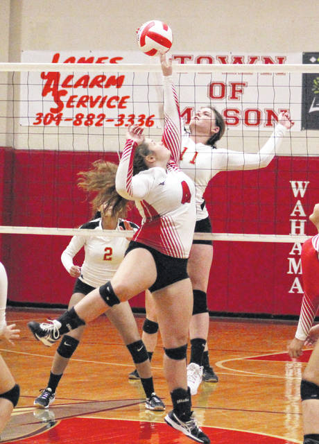 South Gallia sophomore Jessie Rutt (11) tips a ball before Wahama's Harley Roush (4) can reach it at the net during Game 2 of a Sept. 17 TVC Hocking volleyball match in Mason, W.Va.