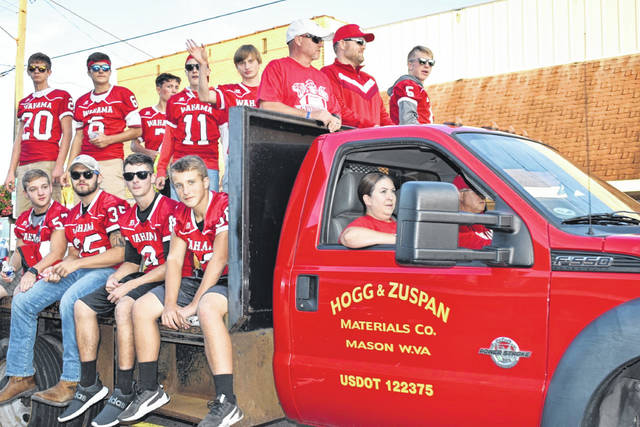 The Wahama Homecoming parade was held Thursday evening through the towns of New Haven and Mason. Pictured are some of the football players and coaches as they make their way along the parade route.