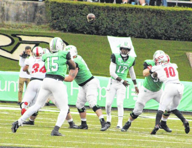 Marshall quarterback Isaiah Green (17) releases a pass downfield to Armani Levias (15) during the second half of an Oct. 26 contest against Western Kentucky at Joan C. Edwards Stadium in Huntington, W.Va.