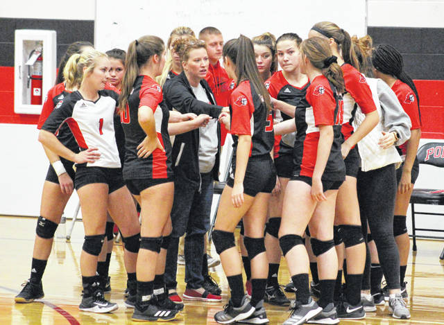 Point Pleasant volleyball coach Marla Cottrill, middle, talks with her team during a timeout in an Oct. 17 volleyball match against Winfield in Point Pleasant, W.Va.