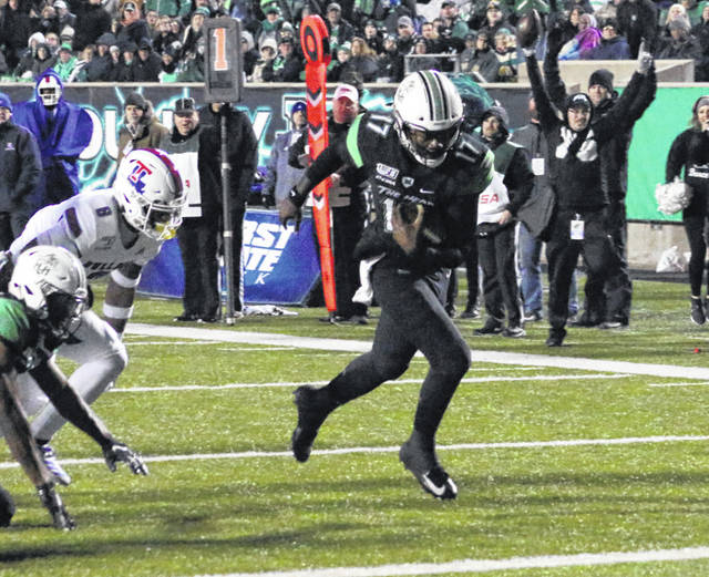 Marshall quarterback Isaiah Green (17) shakes off a pair of Louisiana Tech defenders on his way into the end zone during the third quarter of Friday night's Conference USA matchup in Huntington, W.Va.