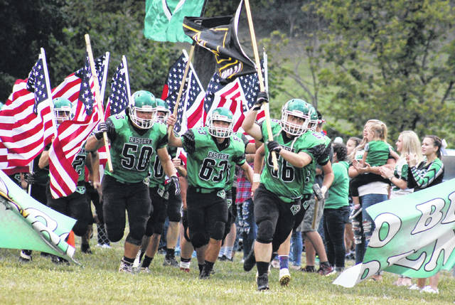 The Eastern football team, led by Will Oldaker (50) Michael Letson (63) and Nick Little (56), runs onto the field at East Shade River Stadium before a Sept. 6 contest in Tuppers Plains, Ohio.