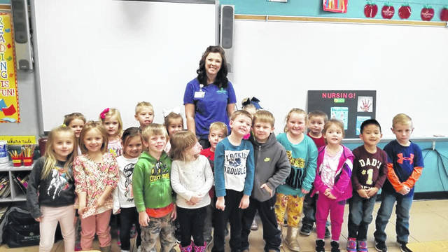 Nurse Jessica Stewart is pictured surrounded by New Haven Elementary pre-school students during Career Day last week. Nearly 30 different professions were represented at the event.