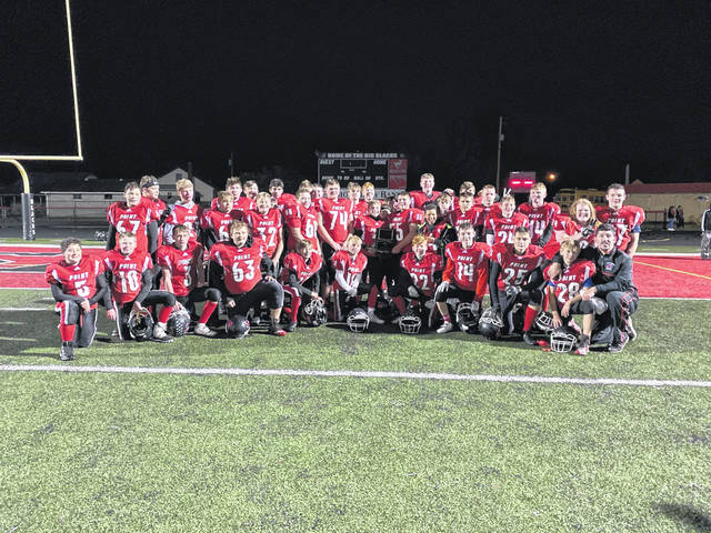 "The Point Pleasant Junior High School Big Blacks football team earned its first MVAC Championship on Thursday night, defeating the Hurricane Redskins at home, 6-0. The team was led to the conference championship by Coach Jimmy Jordan also pictured here with the team following a stormy, cold night at Ohio Valley Bank Track and Field. ""I am proud of the effort that the boys gave. We were able to weather the storm and come through with a team win. Every win is nice, but to win a championship game is special. It's something these boys will remember the rest of their lives,"" Jordan said."
