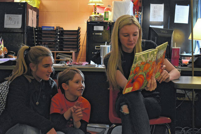FFA students from the Mason County Career Center read to Andrea Henderson's students at Point Pleasant Primary school for Read to Me Day.