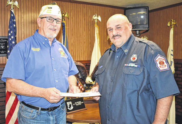 "Steven Sigman, right, a member of the New Haven and Community Volunteer Fire Department, has been named the Stewart-Johnson V.F.W. Post 9926 ""Firefighter of the Year."" He is shown with V.F.W. Commander Ray Varian, who made the presentation."