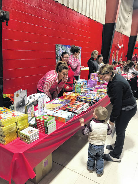 Members of the Mason County Board of Education handed out books to children during past FRN Mason County Family Christmas events.