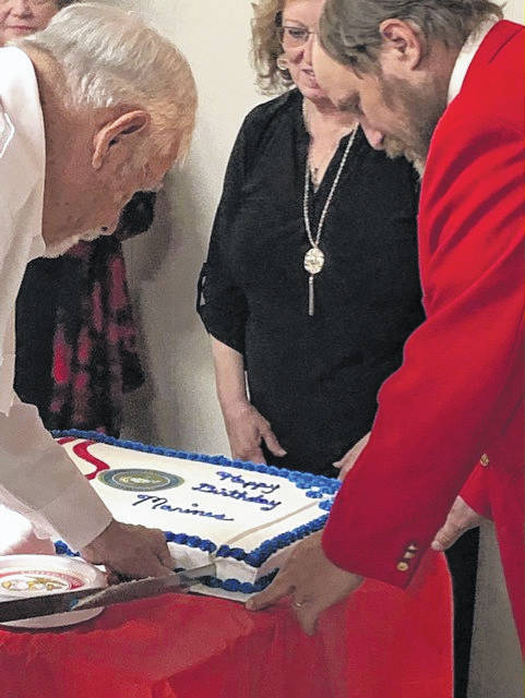 "The traditional ""Cake Cutting Ceremony"" where the cake is cut with a USMC sword and the first piece is given to the oldest Marine, then the youngest Marine."
