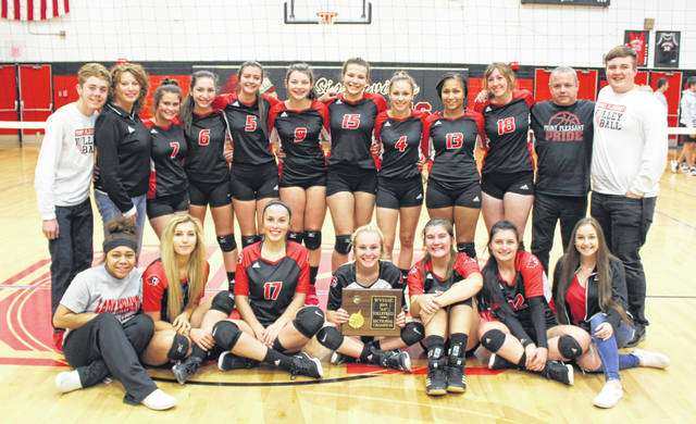 Members of the 2019 Point Pleasant varsity volleyball team pose for a picture after claiming the Class AA Region IV, Section 1 championship on Wednesday night at Sissonville High School.