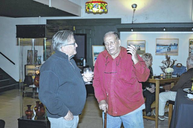 """Charles Ott, 72, of Lincoln County, at right, is the latest painter to have their work featured at Gallery at 409 on Main Street. A reception was held for the artist for his show """"Landscapes"""" on Thursday."""