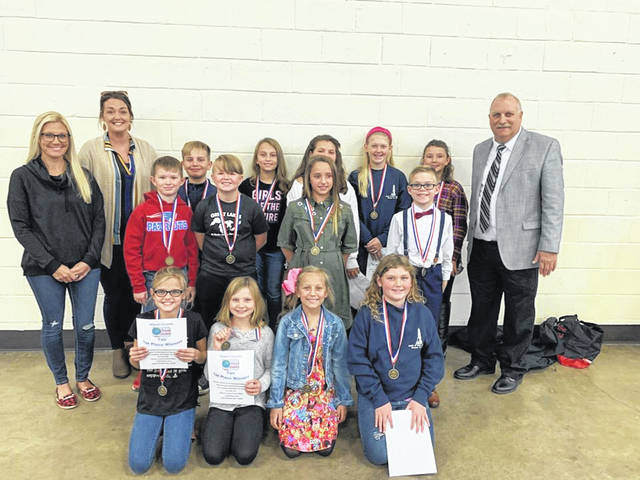 Pictured are students in grades 3 - 5 who competed in the Division 1 competition and won first place in their respective categories in the Social Studies Fair. Also pictured are board members Meagan Bonecutter and Ashley Cossin with Supt. Jack Cullen.