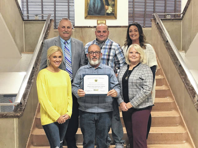 Representatives with the Mason County Board of Education accepted their award of $63,193.24 for the recycling program in the schools. Pictured from left, (back row) Superintendent Jack Cullen, Board President Jared Billings, Board Member Ashley Cossin, (front row) Board Members Meagan Bonecutter, Dale Shobe, and Rhonda Tennant.
