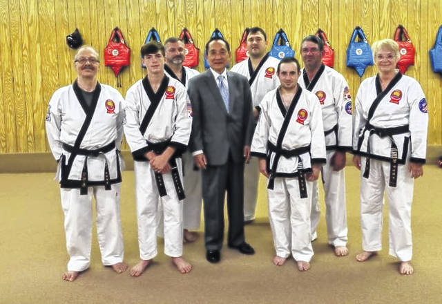 Pictured from left, Master Ted Siders, Bryce Holcomb, Frank Holcomb, Grand Master S.H. Kang, James Lee, Drew Foglesong, Dan Foglesong and Master Pam Siders.