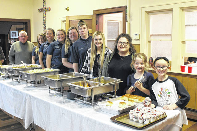 The annual Community Thanksgiving Dinner hosted by the Point Pleasant Presbyterian Church served nearly 250 free meals on Tuesday, including 100 which were delivered to those in the community unable to attend. Church members were supported by students from the Mason County Career Center's FFA chapter. From left, Commissioner and FFA Advisor Sam Nibert, with FFA members Crimson Cochran, Hannah Wood, Penelope Haught, Hannah Spurlock, Michael King, church members Kate Henderson and Kaylee Weaver, along with friends Alyx Tench and Lola Tolliver.