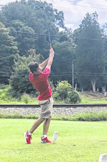 Wahama freshman Conner Ingels hits a tee shot during an Aug. 15 golf match at Riverside Golf Club in Mason, W.Va.