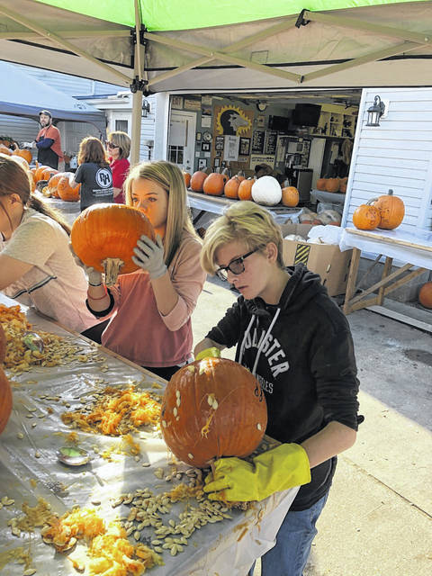 Art students carve pumpkins for display at the Pumpkin House.