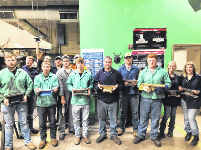 Pictured are some of the first year welding students with their anvils.