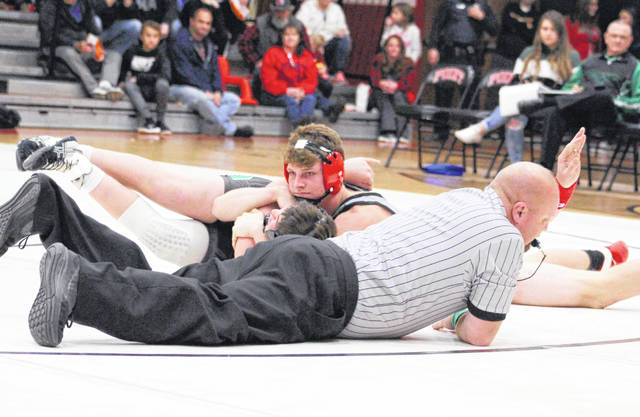 Point Pleasant senior Logan Southall holds a Winfield opponent down for a pinfall during a Dec. 11, 2019, dual match in Point Pleasant, W.Va.