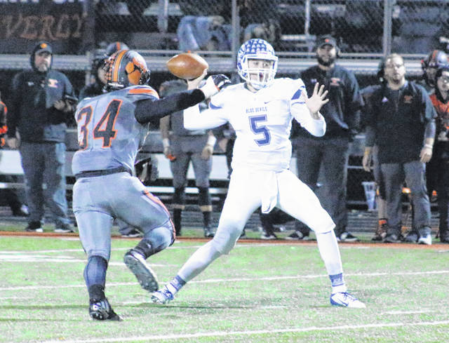 Gallia Academy junior quarterback Noah Vanco (5) releases a pass attempt during a Division IV, Region 15 playoff game against Waverly on Nov. 9 at Raidiger Field in Waverly, Ohio.