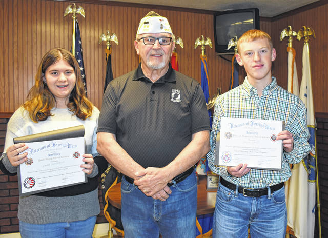Stewart-Johnson V.F.W. Post 9926 of Mason Commander Ray Varian, center, recently recognized winners of the Patriot's Pen and Voice of Democracy competitions. Emma Northup, left, won the Patriot's Pen essay competition for grades 6-8, while David Kapp, right, won the Voice of Democracy audio essay contest for grades 9-12. Both were presented certificates, and will be awarded plaques and cash prizes at the post's Loyalty Day dinner in May.
