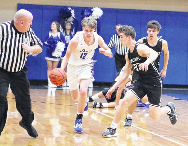 Gallia Academy senior Reece Thomas (12) dribbles the ball up the court during the first half of Friday night's OVC boys basketball contest against Coal Grove in Centenary, Ohio.