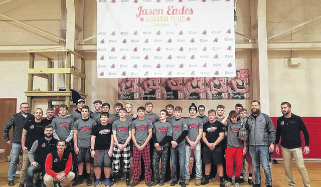 Members of the Point Pleasant wrestling team pose for a picture after winning the 2019 Jason Eades Memorial Duals championship on Saturday in Point Pleasant, W.Va.