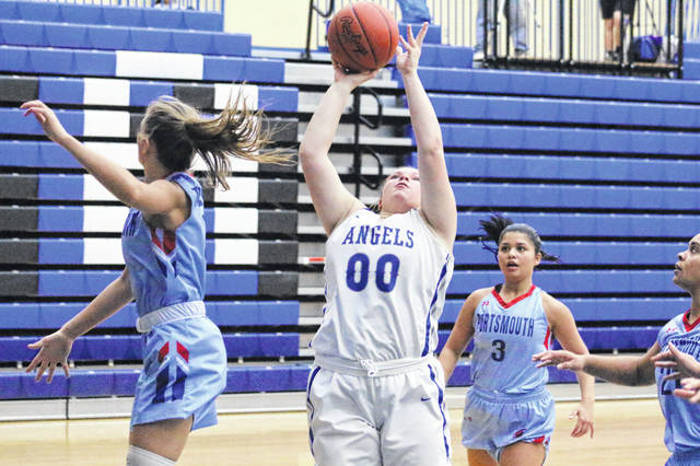 Gallia Academy freshman Chanee Cremeens (00) releases a shot attempt during the second half of Monday night's OVC girls basketball contest against Portsmouth in Centenary, Ohio.