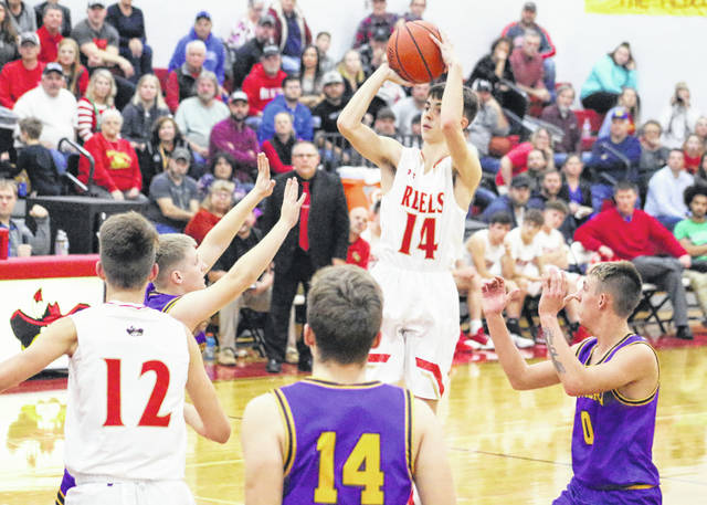 South Gallia junior Andrew Small (14) releases a shot attempt during the first half of Tuesday night's TVC Hocking boys basketball contest against Southern in Mercerville, Ohio.
