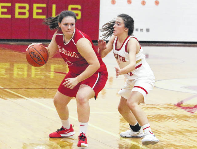 Wahama junior Torre VanMatre, left, dribbles past a South Gallia defender during the second half of Thursday night's TVC Hocking girls basketball game in Mercerville, Ohio.
