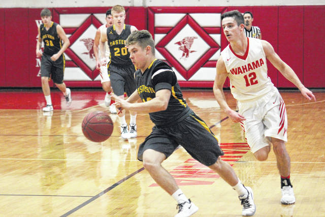 Eastern junior Blake Newland leads Wahama senior Abram Pauley (12) on a fast break, during the Eagles' 60-42 triumph on Friday at Gary Clark Court in Mason, W.Va.