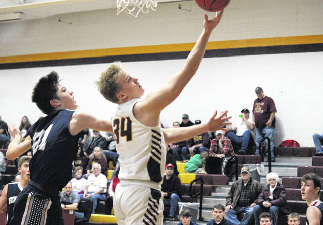 Meigs sophomore Morgan Roberts (34) tries a layup in front of a New Hope Christian defender, during the Marauders' 55-38 victory on Saturday in Rocksprings, Ohio.
