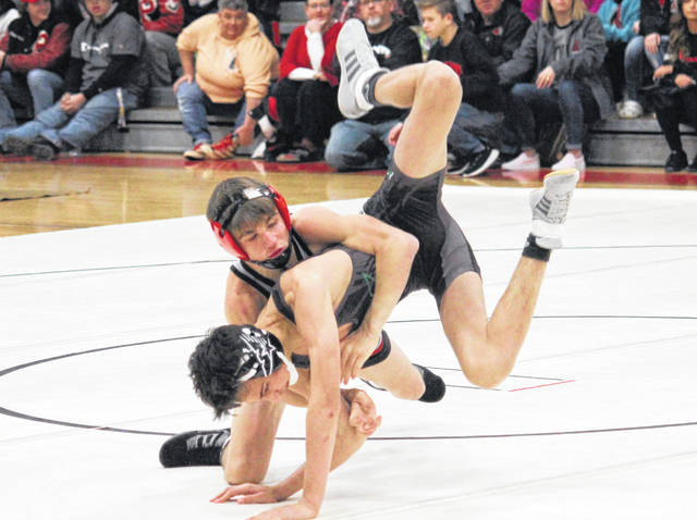 Point Pleasant junior Parker Henderson takes a Winfield opponent down to the mat during a 106-pound match held on Dec. 11 in Point Pleasant, W.Va.